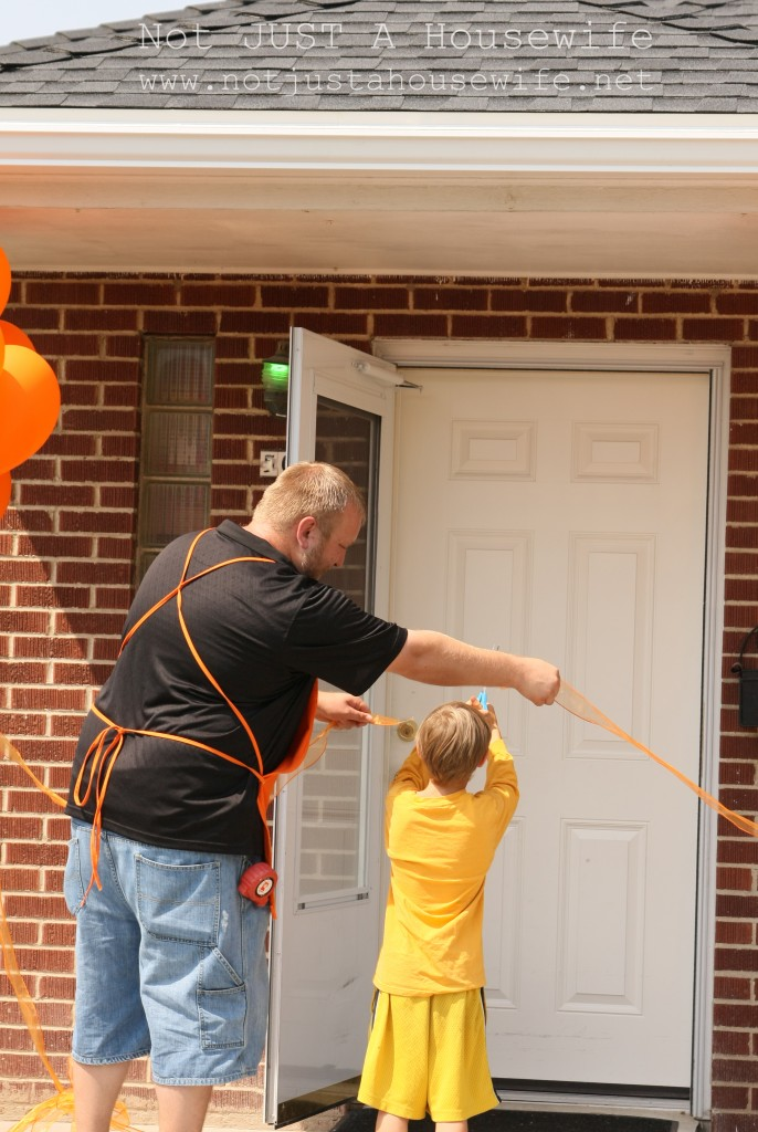 ribbon cutting ceremony 686x1024 The Dilley Familys Home Makeover REVEAL!!!!!