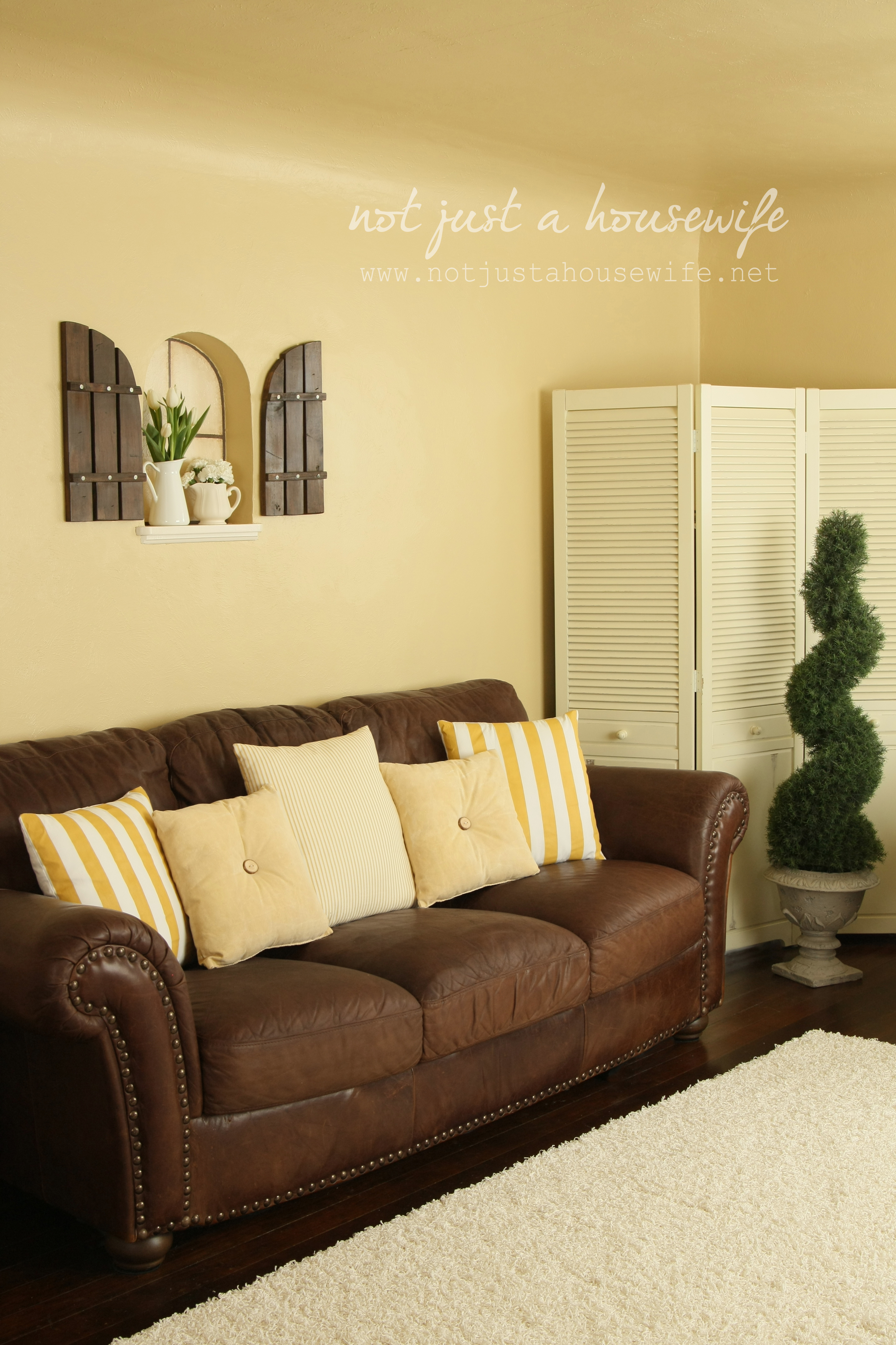 Cheerful yellow family room the big reveal stacy - Family pictures on living room wall ...
