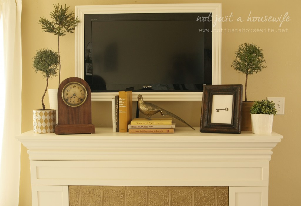 family room mantel 1024x703 Cheerful Yellow Family Room {The BIG Reveal!!!!}