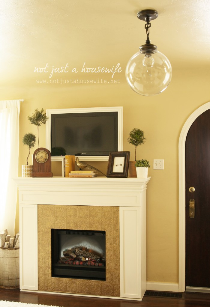 fire place electric insert edited 1 700x1024 Cheerful Yellow Family Room {The BIG Reveal!!!!}