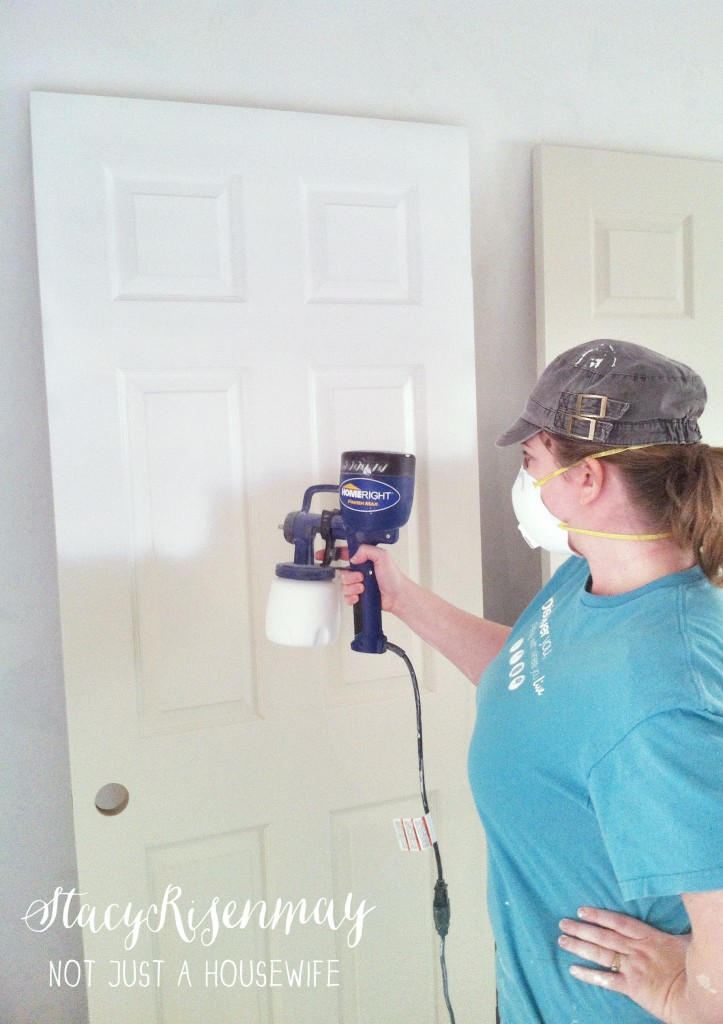 painting door with HomeRight Finish Max 723x1024 {Painting a basement} Finish Max Sprayer Giveaway!