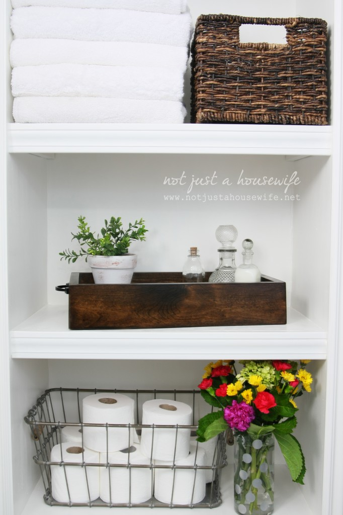 bathroom shelves decorated1 682x1024 How To Decorate With Plants