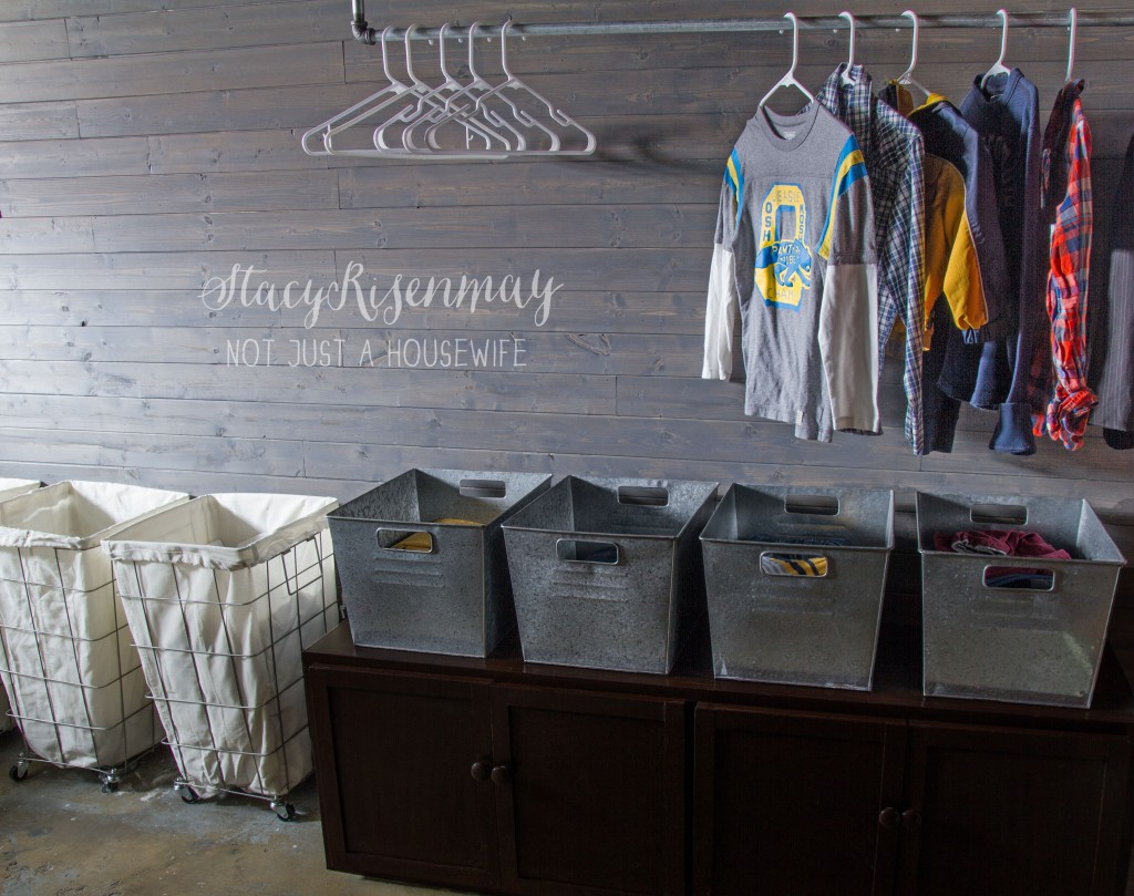 laundry room organized with metal bins
