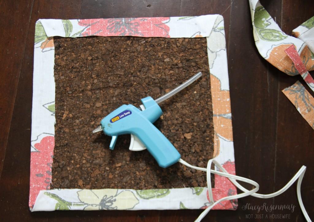 glue fabric on cork board