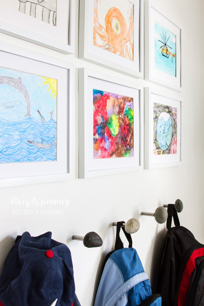 hang your child's art above their hooks