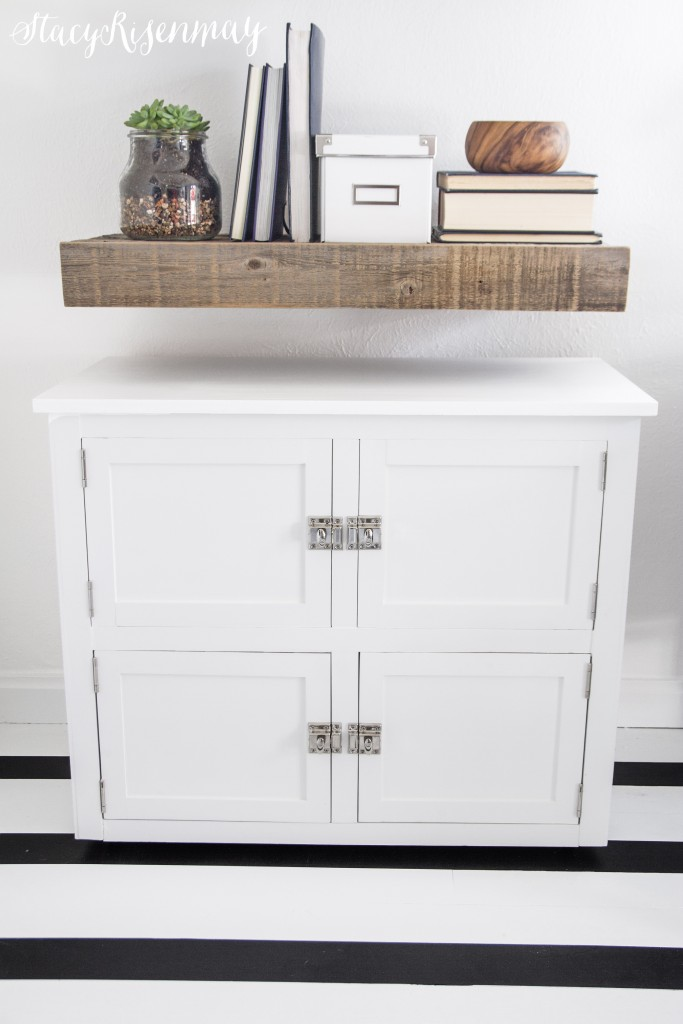 office cabinet. Top is filing cabinet with faux doors and the bottom door open for storage.