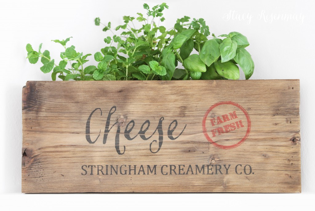 cheese crate used as planter for herbs
