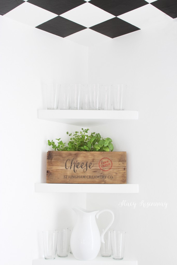 dining room shelves with herbs in cheese crate