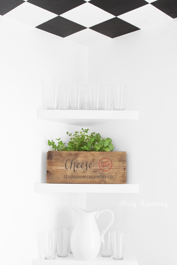 kitchen shelves with herbs in wooden cheese crate