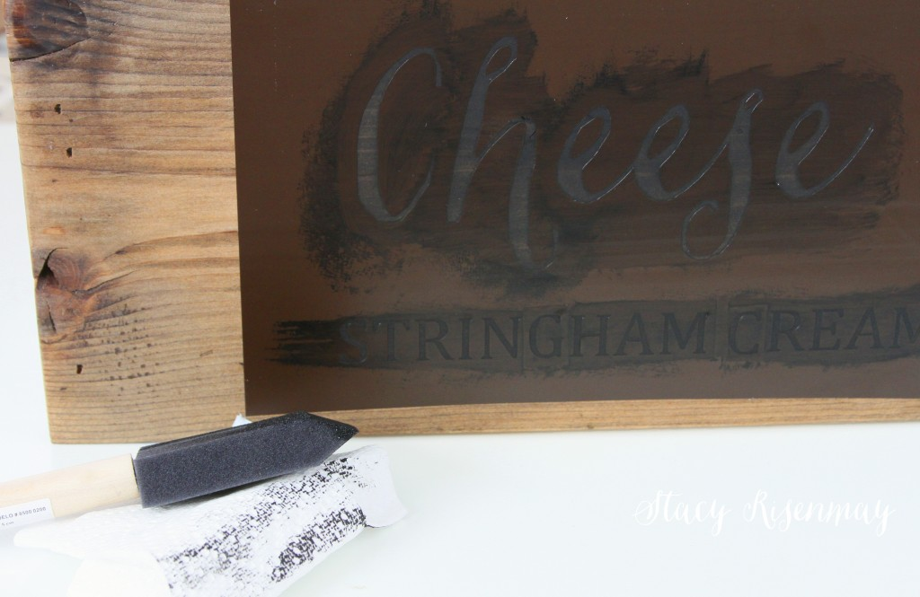stenciling lettering on wood crate
