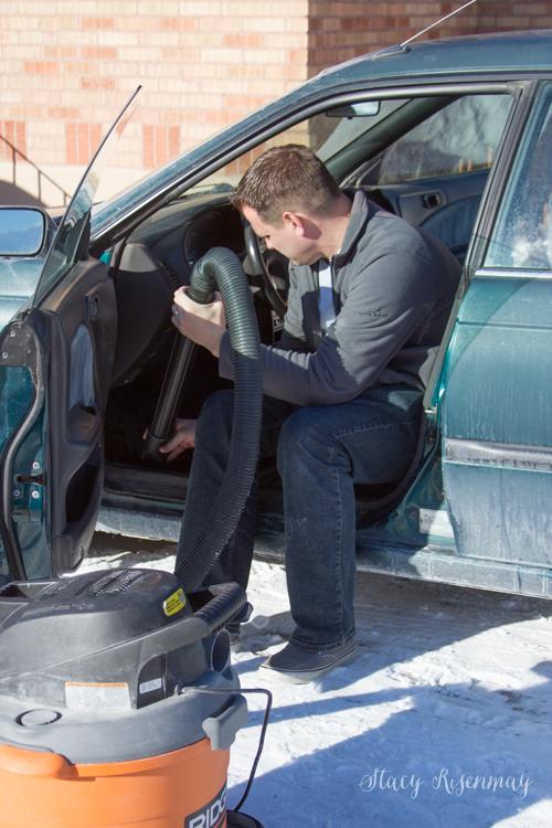 vacuuming-out-car