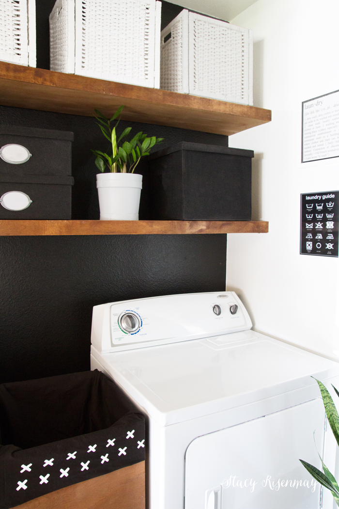 black-and-white-laundry-room-with-floating-shelves