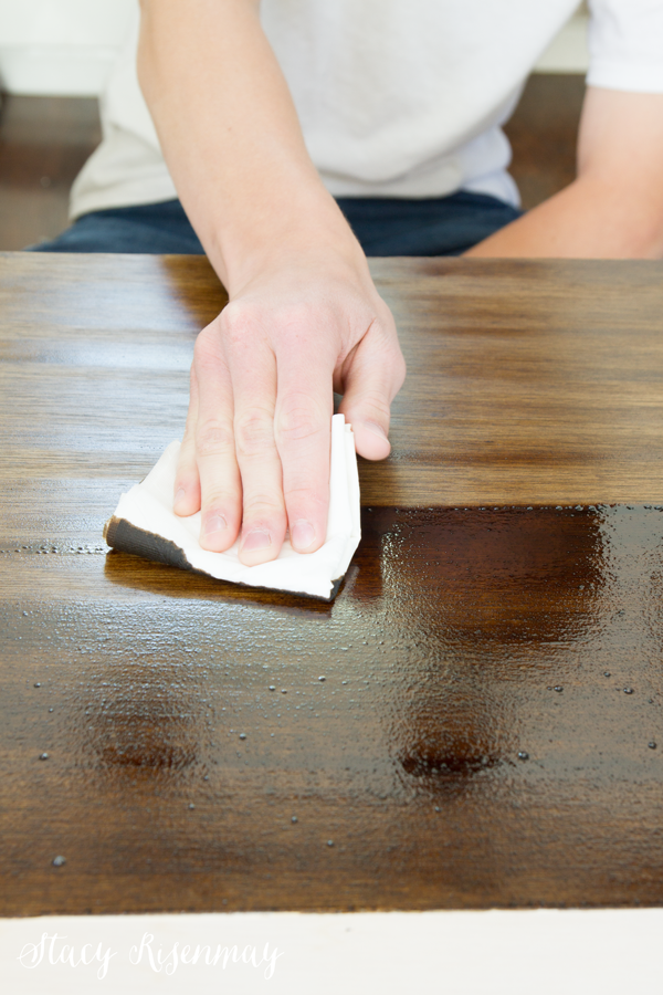 wiping-off-excess-stain