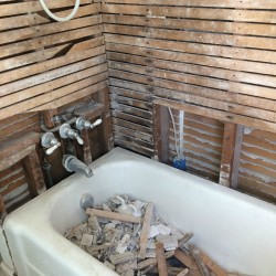 lathe and plaster in bathroom