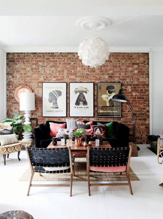 exposed brick and hanging pictures