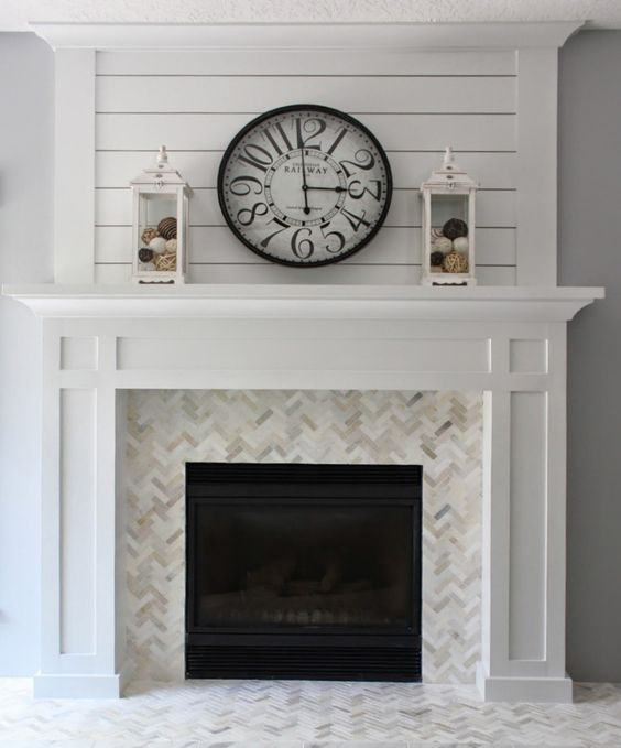 herringbone tile on fireplace