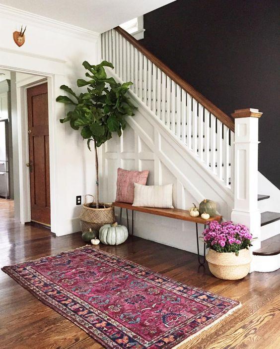purple rug in entryway