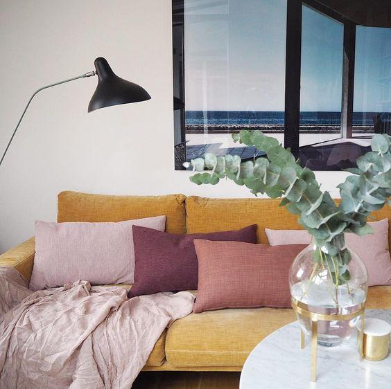 purple pillows on yellow sofa