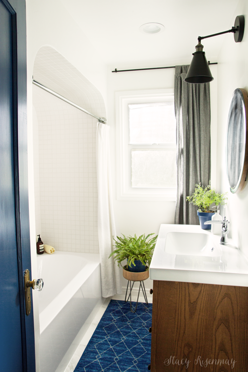 blue and white bathroom with arched shower nook