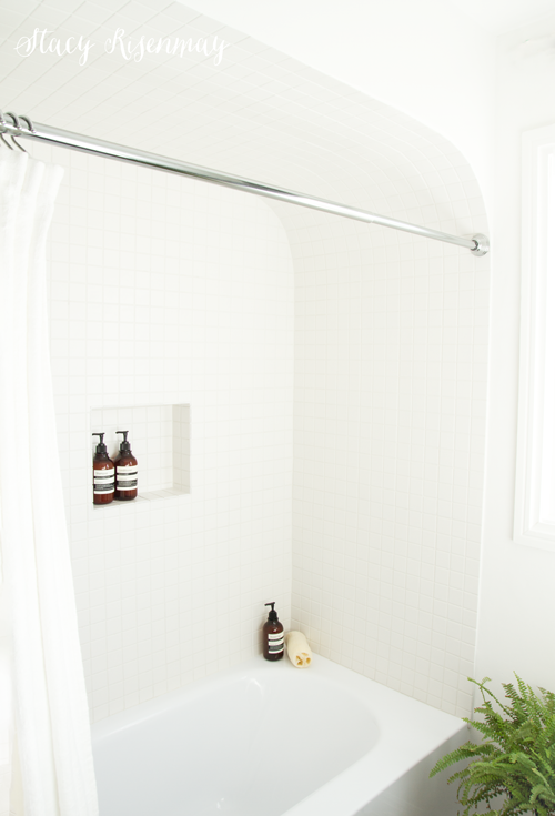 white shower tile in arched nook
