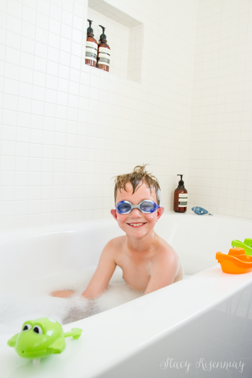 boy playing in bathtub