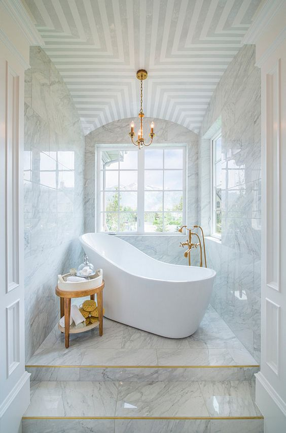 marble bathroom with decorative ceiling