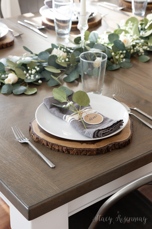 farmhouse table with eucalyptus centerpiece