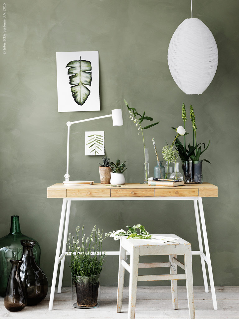 Sage green walls with desk and chair