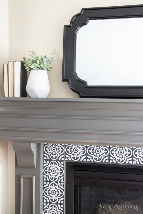 gray mantel and cement tiles on fireplace