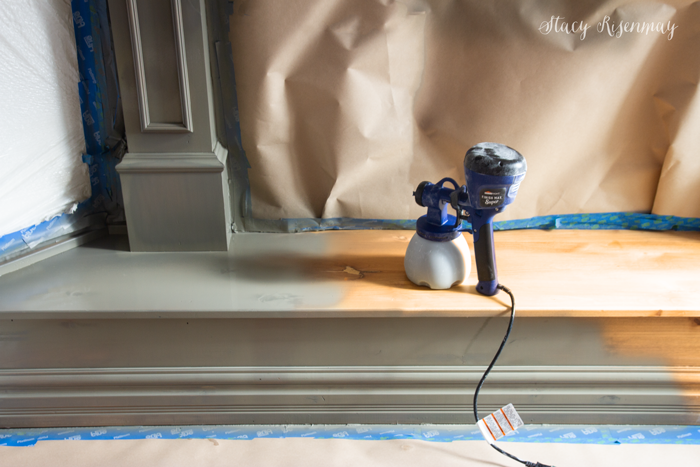 Painting a fireplace with a paint sprayer