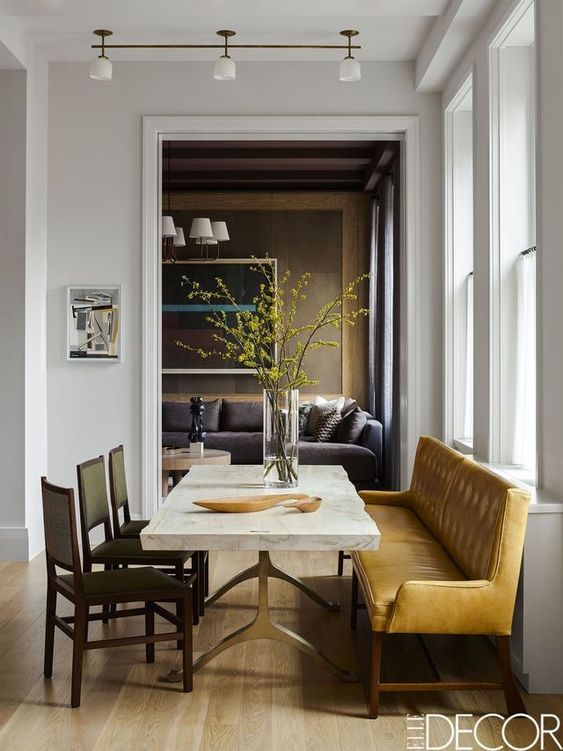 dining room with yellow bench