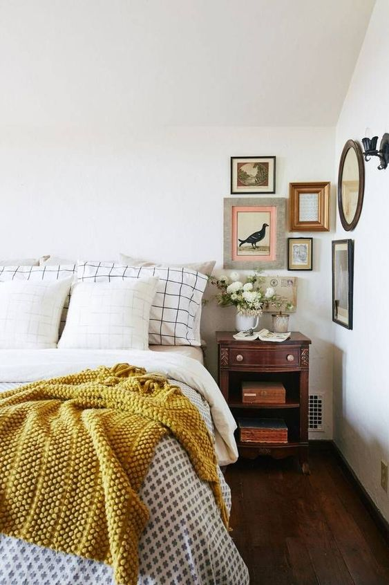 bedroom with yellow throw blanket on bed