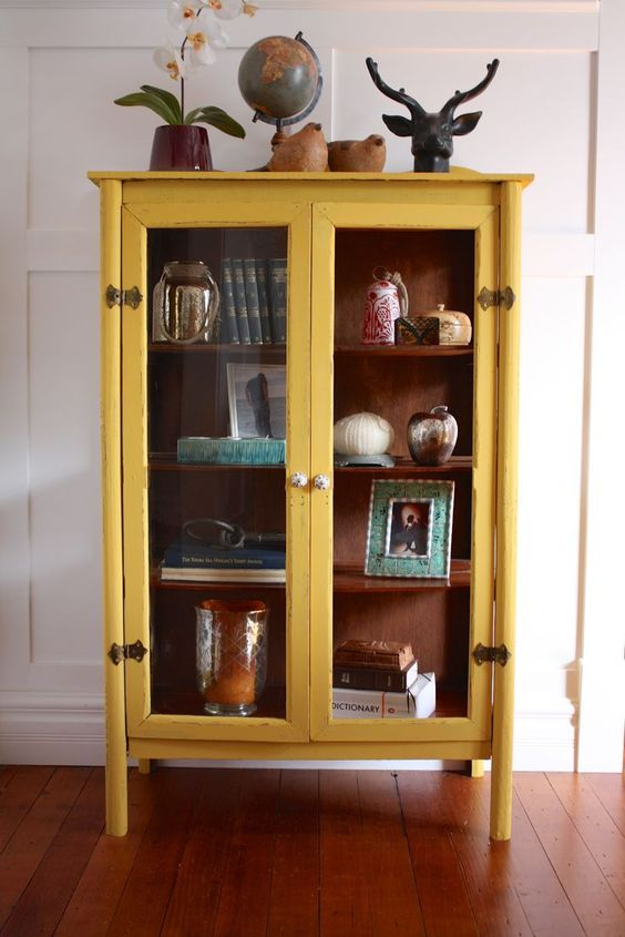 yellow cabinet with glass fronts