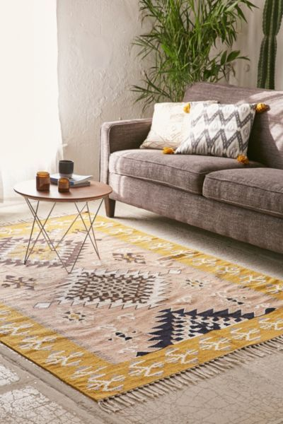 yellow rug and gray sofa