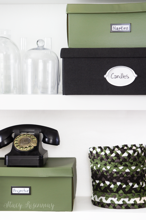 Green and black items on office shelves