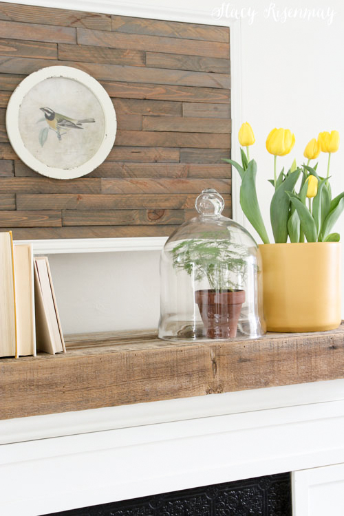 yellow planter and tulips on mantel