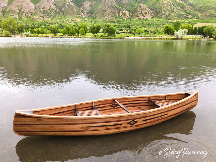 wood canoe on the water
