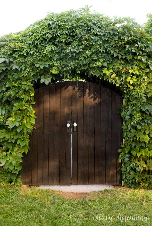 An arched backyard gate